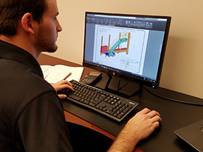 Worker using CAD software on computer