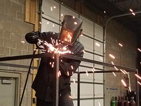 Welder welding metal frame