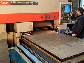 Mazak laser cutter with operator